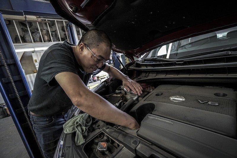 Auto Mechanic fixes a car.