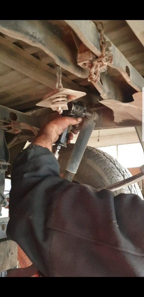 removing the bolts from the shock tower