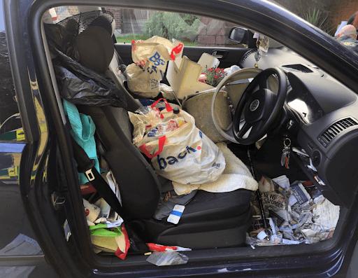 food leftovers formed a nasty vinegar smell inside a car